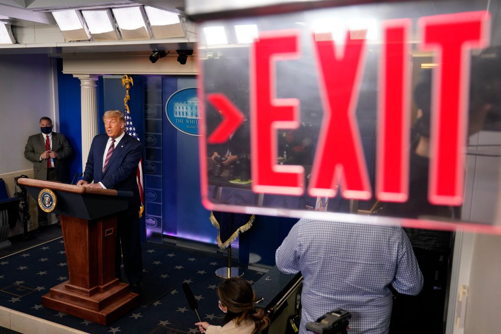 This image has an empty alt attribute; its file name is donald-trump-exit-sign.jpg